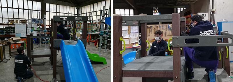 trabajadores de jolas trabajando con las medidas de seguridad para el covid-19
